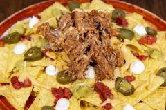 Nacho Plate Chili Con Pork ylikypsästä possun niskasta
